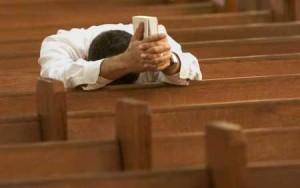 man praying alone